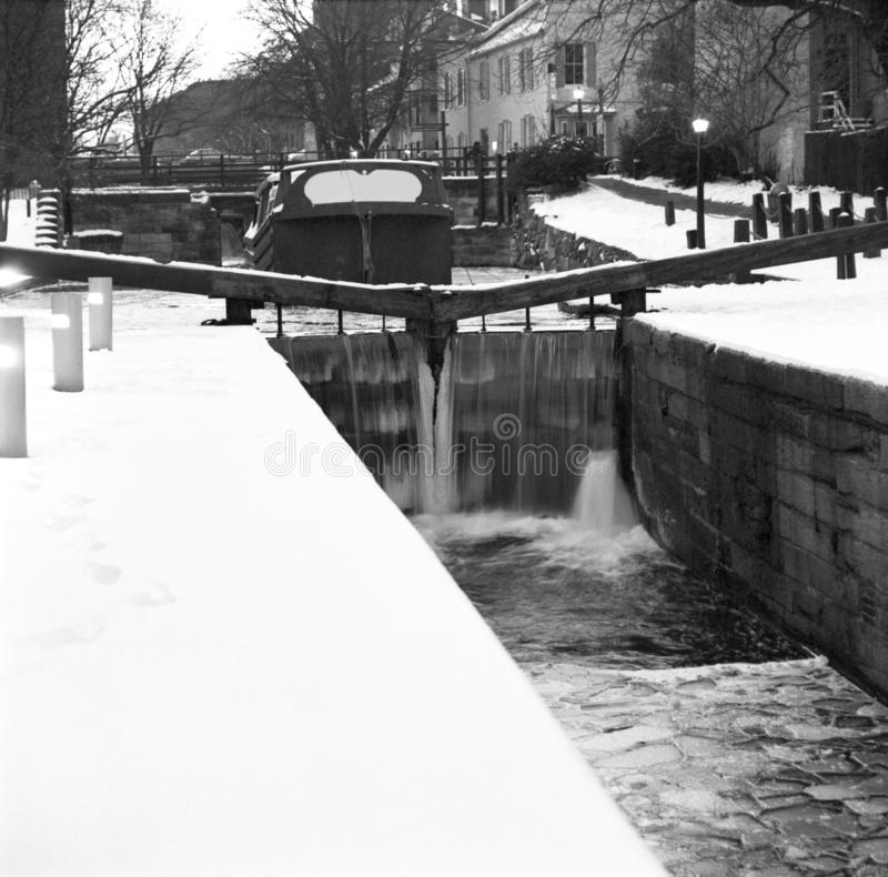 Georgetown C&O Canal in the Winter in February. Black and white photo of barge and the c&o canal in washington dc in georgetown in winter. This is a scan from stock images