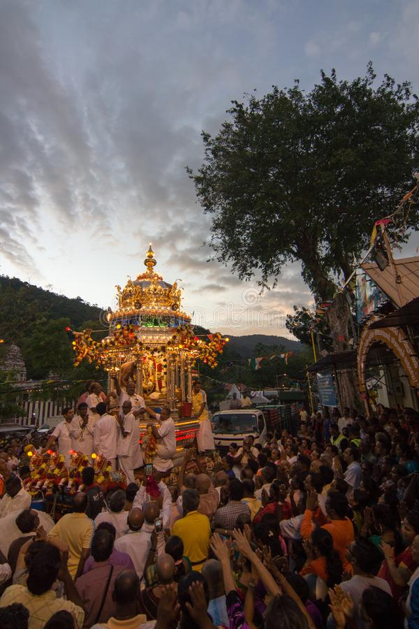 Golden statue of Lord Muruga move on to Silver Chariot`s at Nattukotai Chettiar Temple during Thaipusam Festival. stock photography