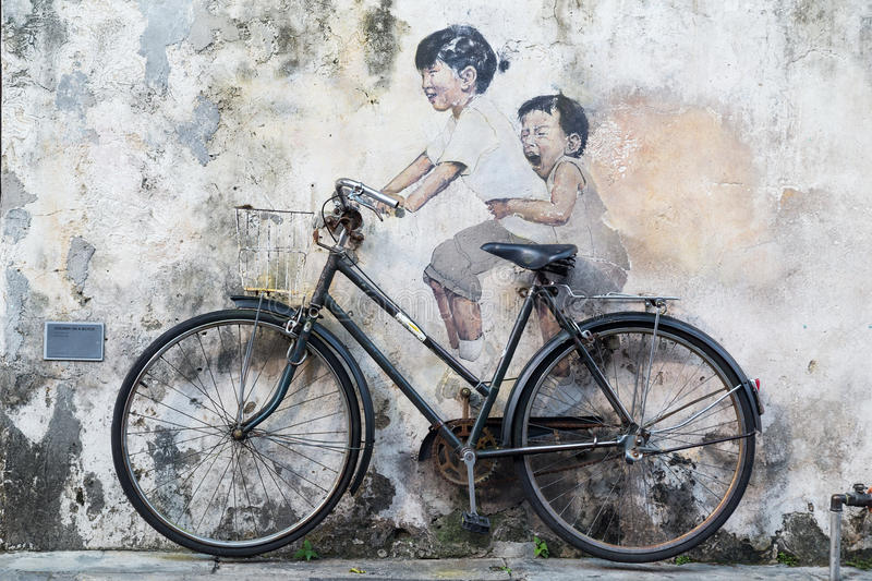 Georgetown, Penang/Malaysia - circa October 2015: Street art and graffiti paintings on the walls of the building in old Georgetown royalty free stock image