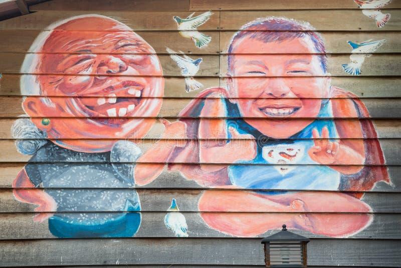 Georgetown Penang/Malaysia - circa Oktober 2015: Gatakonst- och grafittimålningar på väggarna av byggnaden i gamla Georgetown royaltyfri foto