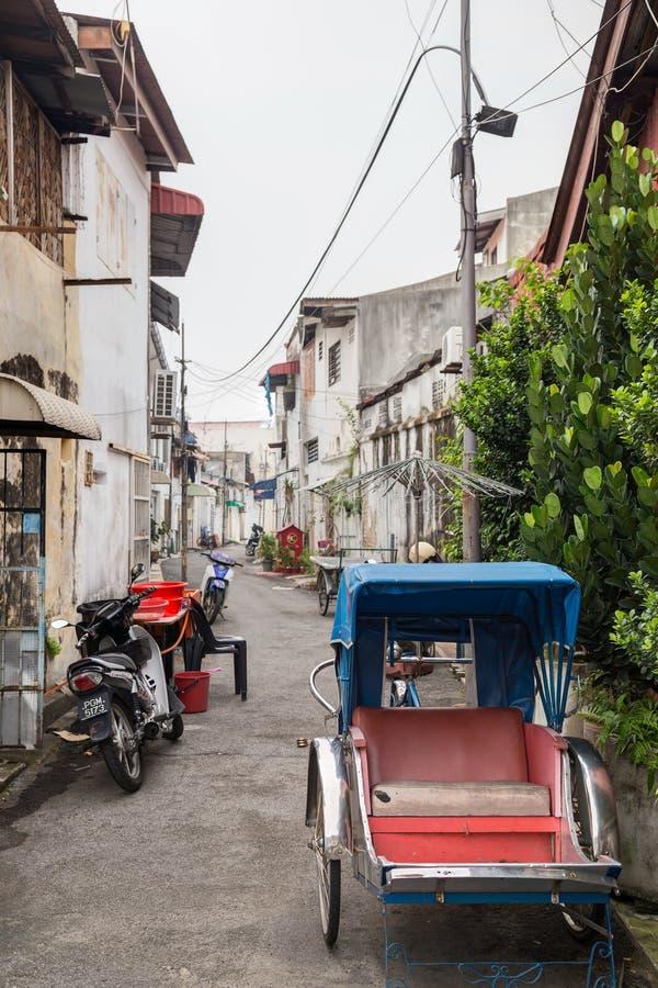 Georgetown, Penang/Maleisië - circa Oktober 2015: Rikshawauto in Georgetown, Penang, Maleisië royalty-vrije stock foto