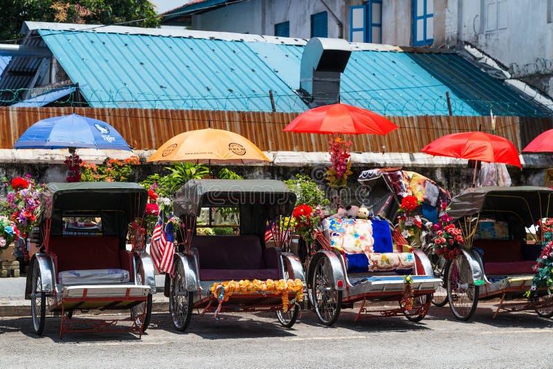 Georgetown, Penang/Maleisië - circa Oktober 2015: Rikshawvervoer in Georgetown, Penang, Maleisië royalty-vrije stock afbeeldingen