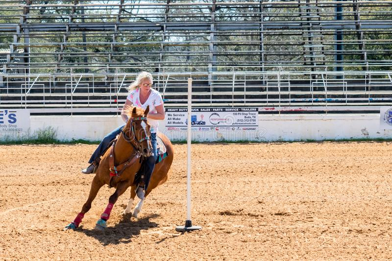 Cowgirl and Horse in Competition stock image