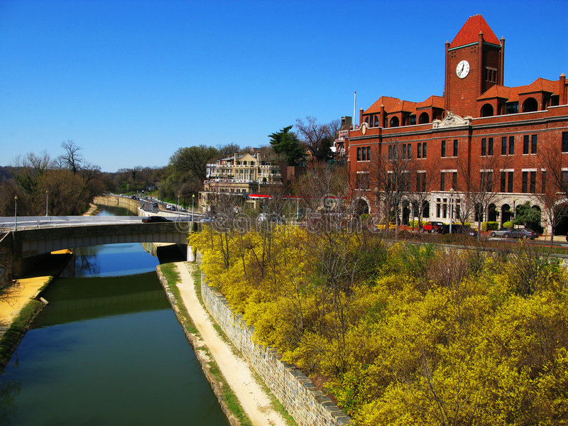 Georgetown University Car Barn and Canal. Flowers bloom along the canal adjacent to the Georgetown University car barn on a warm sunny day in the beginning of stock photos