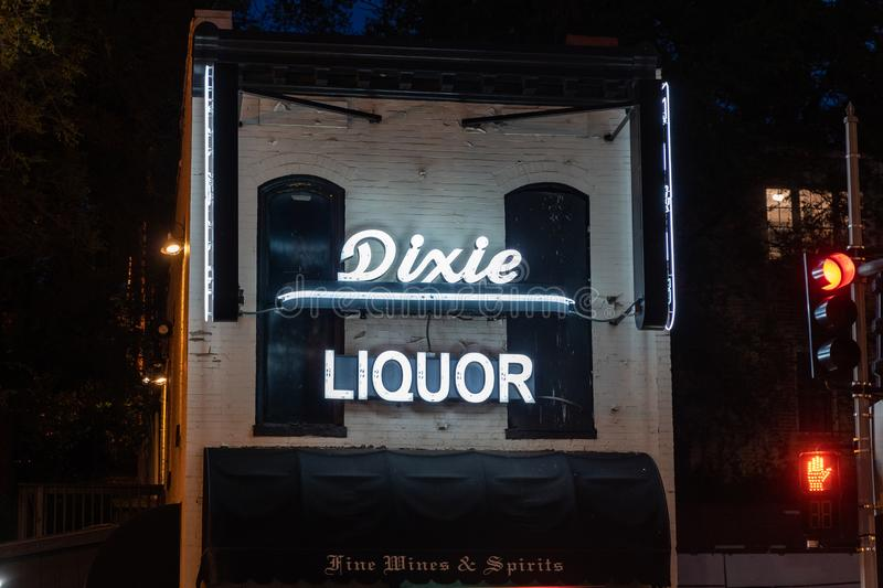 Georgetown, Washington DC - May 10, 2019: Dixie Liquor exterior view, with the neon sign lit up at night. This is the oldest stock photo