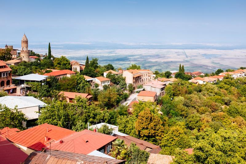 Georgia landscape Signagi, Kakheti. Old looking village aerial view with roof tops, church, and scenic summer landscape Signagi, Kakheti, Georgia royalty free stock photos