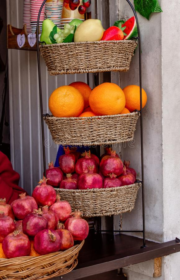 Georgia, sale of pomegranates and oranges. Fresh juice in the street. Georgia, sale of pomegranates and oranges. Fresh juice stock photo