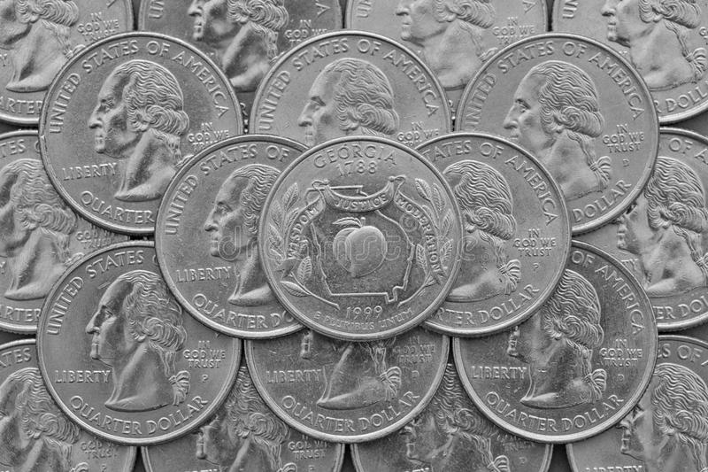 Georgia State and coins of USA. Pile of the US quarter coins with George Washington and on the top a quarter of Georgia State royalty free stock images
