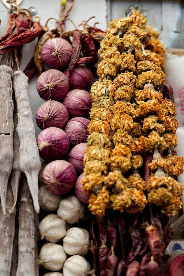 Georgia, Tbilisi, The central city market. Onion and garlic braids.  royalty free stock image