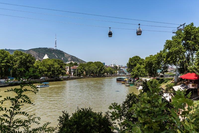 Georgia, Tbilisi - July, 3, 2018. Kura river, Narikala castle, funicular and Old Town of Tbilisi. Georgia royalty free stock image