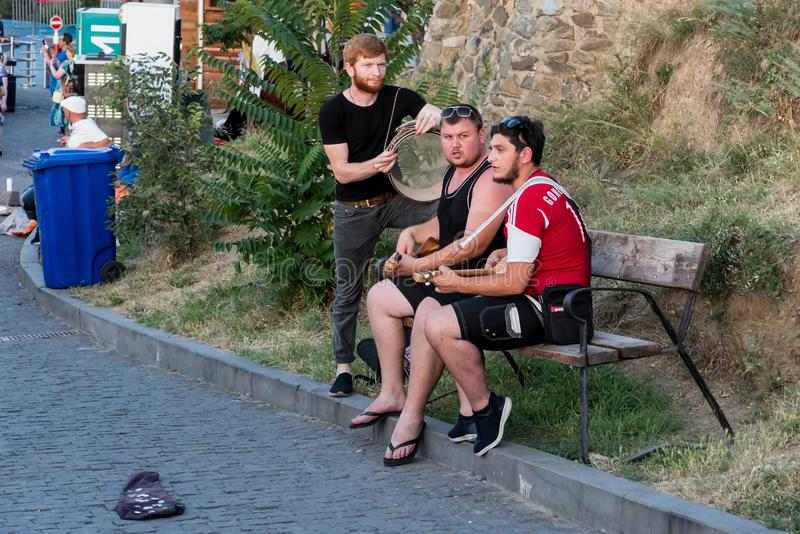 Georgia, Tbilisi - July, 4, 2018. Street musicians playing, singing song stock photo