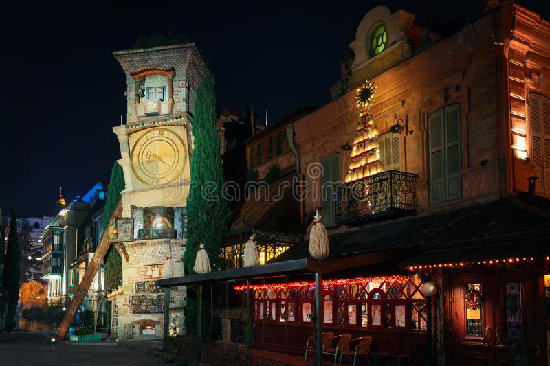 Georgia, Tbilisi - 20.12.2019. - Night time in Tbilisi old town. Famous Rezo Gabriadze clock tower and cafe before new years eve stock photos