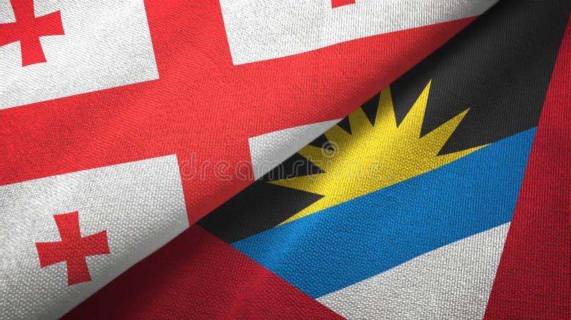 Georgia- und Antigua und Barbuda-zwei Flaggentextilstoff, Gewebebeschaffenheit vektor abbildung
