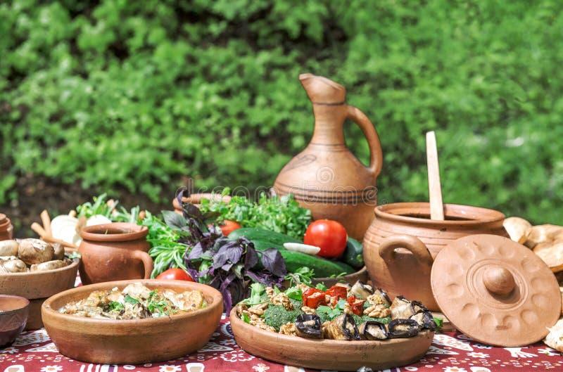 Georgian food appetizer Vegetables herbs Dinner table royalty free stock image