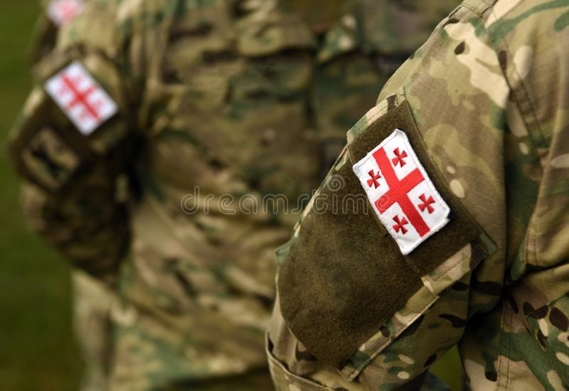 Georgian patch flag on soldiers arm. Georgia army uniform. Georgia troops royalty free stock photo