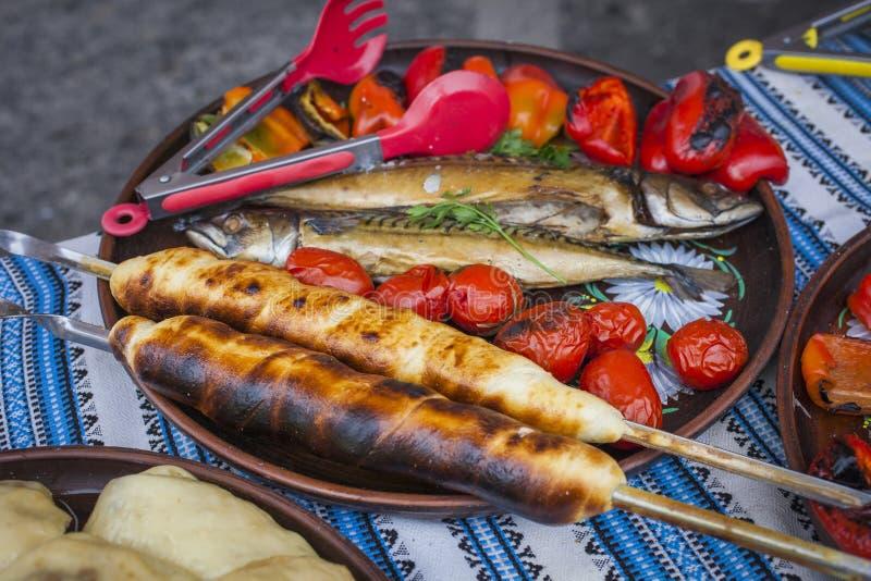Georgian traditional dish - khachapuri, pastry with cheese tomatoes stock photo