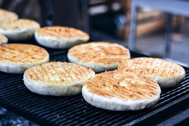 Georgian traditional dish khachapuri, pastry flat cake cheese-filled bread fried on the grill, BBQ. Fresh hot tasty street food in stock photography