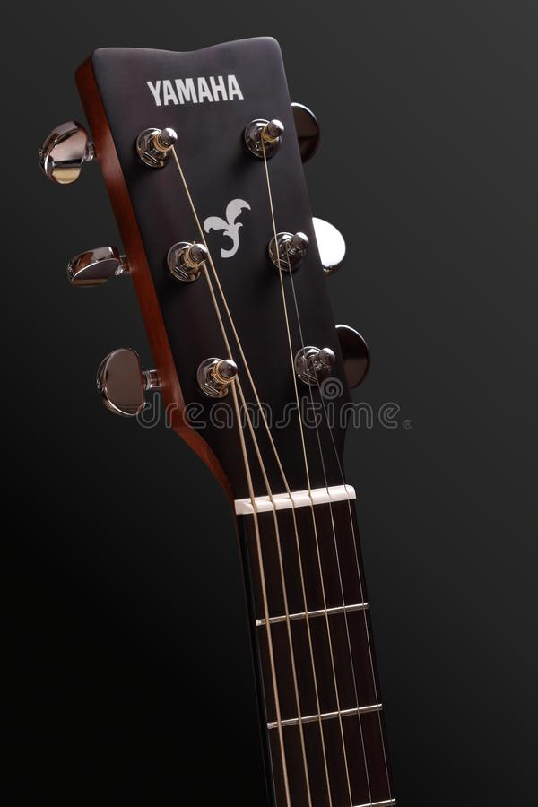Yamaha guitar head with tuning pegs and neck with fingerboard, frets and nut. Georgievsk, Russia - May 30, 2018: Guitar head with tuning pegs and neck with stock images