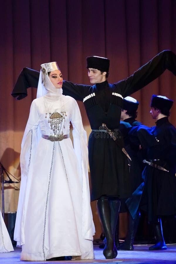 Georgisch Nationaal Ballet Sukhishvili, wereldberoemde dansers, vrijagedans bij overleg in Vinnytsia, de Oekraïne, 25 02 2012 stock afbeeldingen