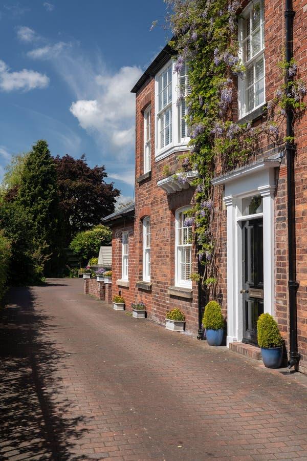 Georgisches Haus durch Stadtpark in Oswestry Shropshire lizenzfreie stockbilder