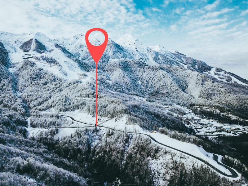 Geotag point on road somewhere in mountains. trees covered with snow. aerial view b. Geotag point on road somewhere in mountains. trees covered with snow. aerial royalty free stock images