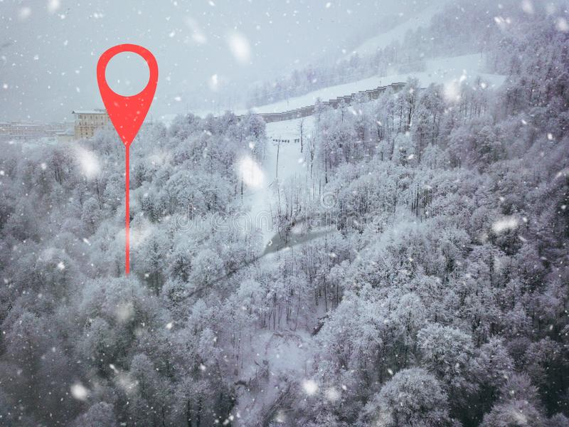 Geotag point on road somewhere in mountains. trees covered with snow. aerial view b. Geotag point on road somewhere in mountains. trees covered with snow. aerial royalty free stock photo