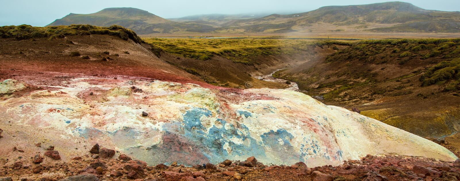 Geothermal area with colorful mineral rocks. Geothermal area in Iceland near Reyjavik with colorful mineral rocks royalty free stock photography