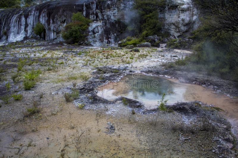 Geothermal hot springs and steam from colorful hot pools stock photo