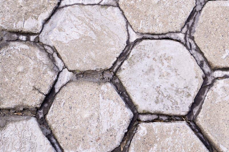 Gepflasterter B?rgersteig des Hexagons Fliese Hintergrund, st?dtisch stockbild