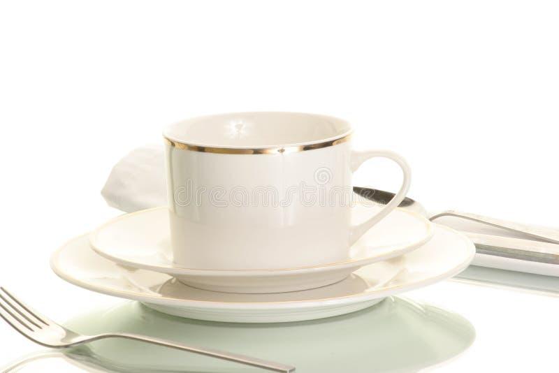 Geräte, Teller und Cup stockfotografie