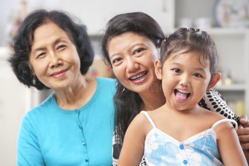 Geração três de fêmeas asiáticas imagens de stock
