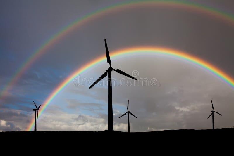 Gerador de vento no fundo do arco-íris imagens de stock