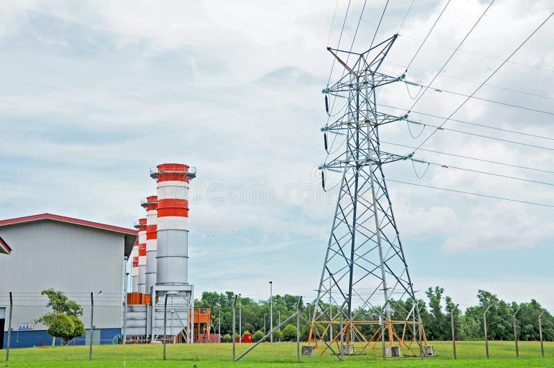 Gerador e pilão da energia eléctrica foto de stock
