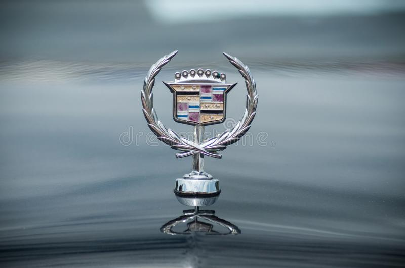 Closeup of Cadillac logo on car front parked in the street stock photo