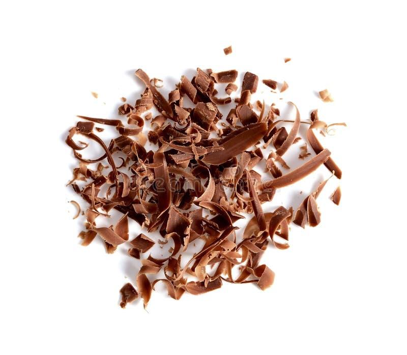 Geraspte chocolade op witte achtergrond stock foto's