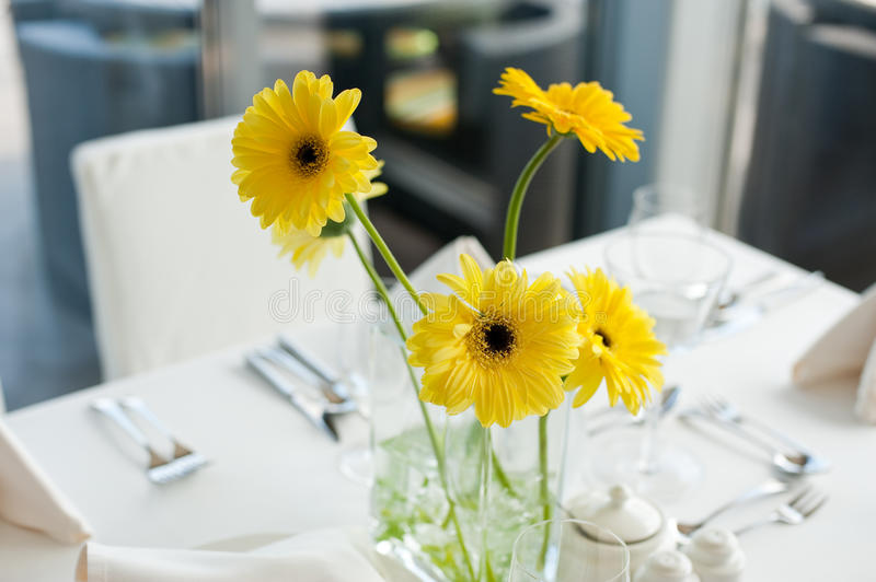 Gerbera daisy flowers on the table. Interior Arrangement with yellow flowers stock photography