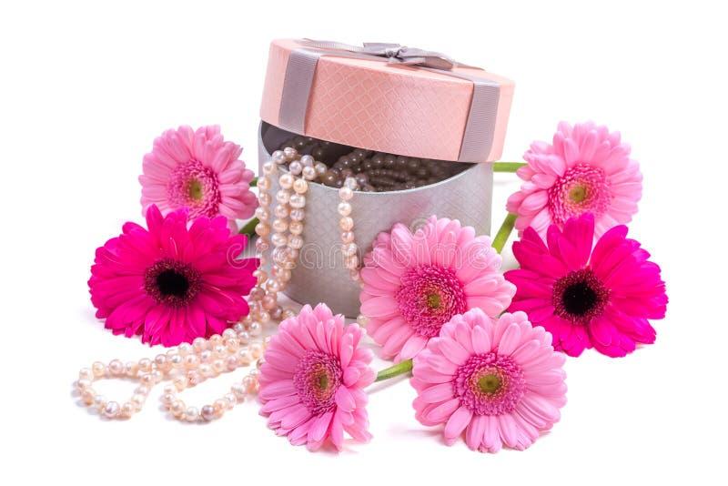 Gerbera flowers. Pink gerberas and pearls. Present. royalty free stock image