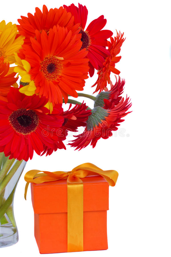 Download Gerbera Fresh  Flowers In Glass Vase With Gift Royalty Free Stock Image - Image: 33599826