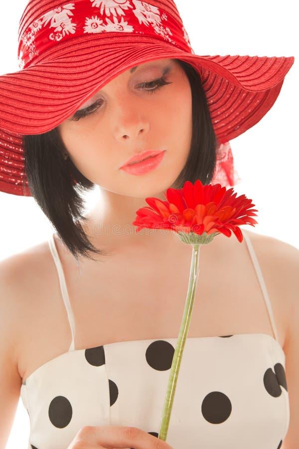 gerbera som ser den röda kvinnan royaltyfri fotografi