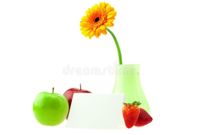Gerbera in una cartolina delle mele del vaso immagine stock libera da diritti