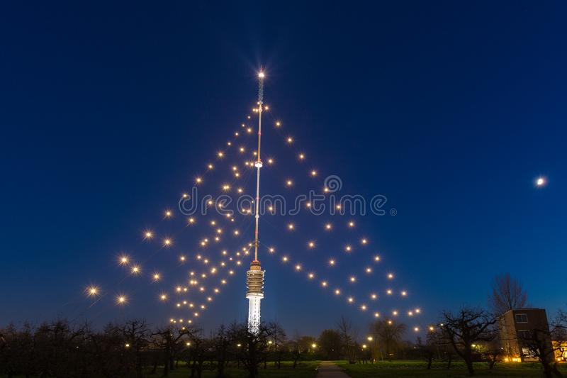 Gerbrandy tower - Largest christmas tree in the world. IJSSELSTEIN, THE NETHERLANDS - December 13, 2018: The Gerbrandy tower is the Largest christmas tree in the stock image