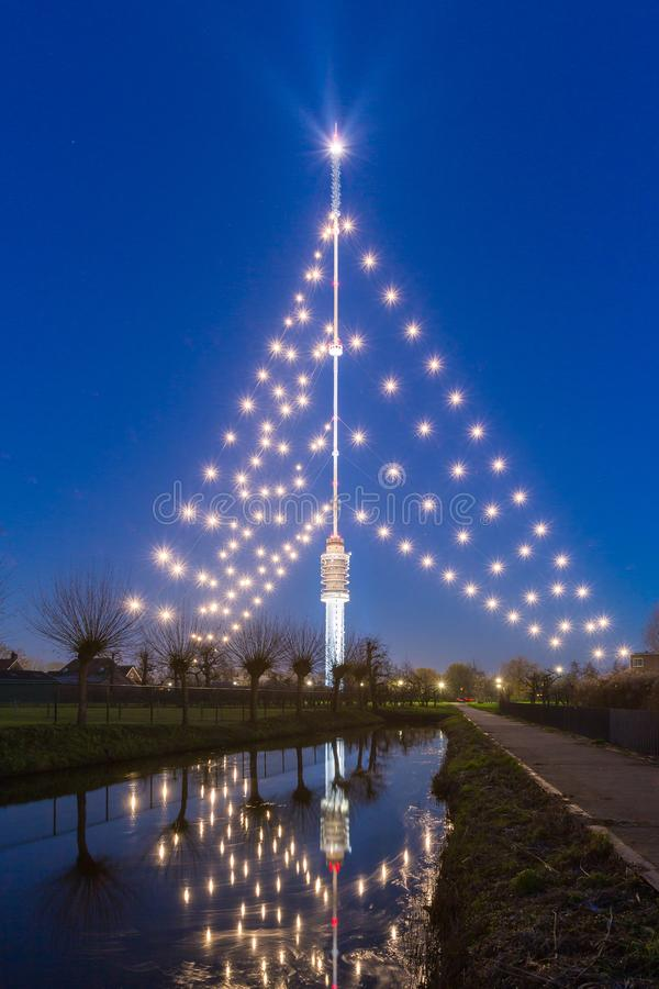 Gerbrandy tower - Largest christmas tree in the world. IJSSELSTEIN, THE NETHERLANDS - December 13, 2018: The Gerbrandy tower is the Largest christmas tree in the royalty free stock photo