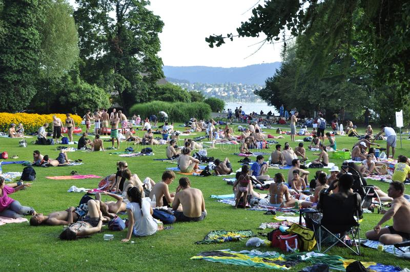 Lake Zürich: people enjoying summertime in the China park stock image