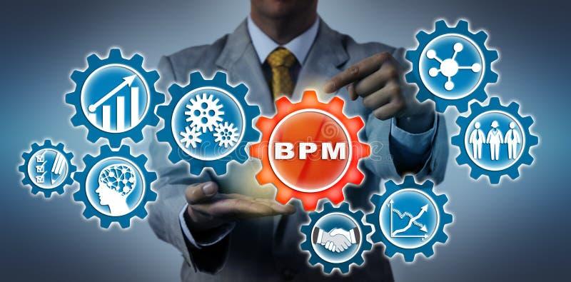 Gerente Highlighting BPM no trem de engrenagem virtual fotos de stock