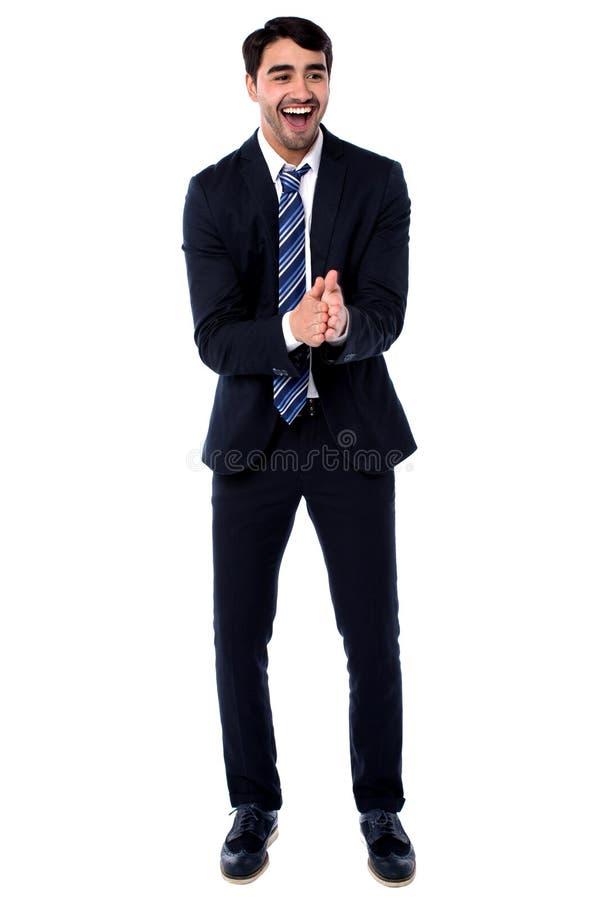 Gerente masculino entusiasmado que aplaude fotografia de stock