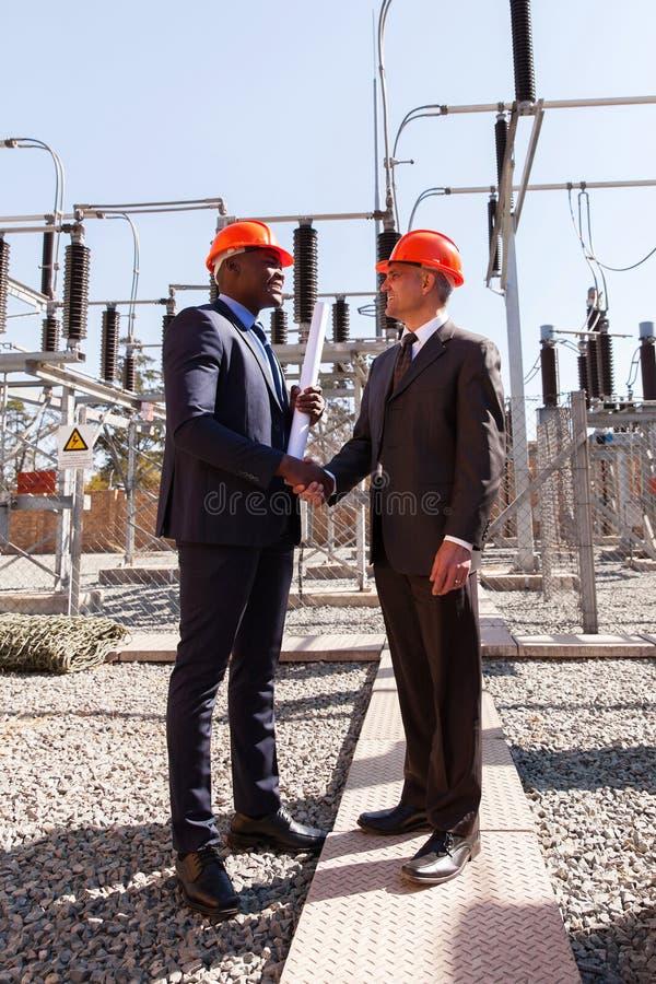 Gerentes de companhia da eletricidade fotografia de stock