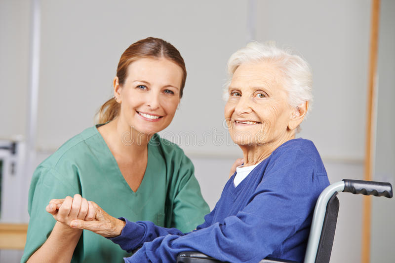 Geriatric care with nurse and senior woman royalty free stock photos