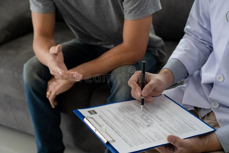 Geriatric doctor or geriatrician concept, Doctor visiting with patient in room and hearing serious disease diagnose writing on stock images