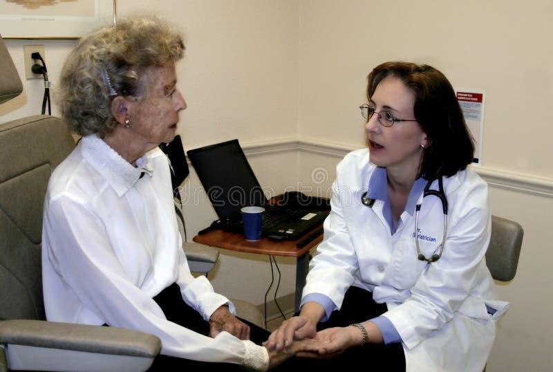 Geriatrician and elderly woman stock photos