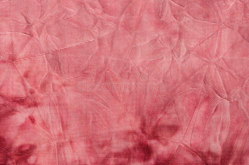 Gerimpelde batik textiel, rozerood stock afbeelding